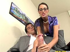 Horny brunette office chick sucks a dick and licks balls. Then she lies down on a table and spreads her legs. After that she gets fucked hard and deep by her colleague.