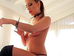 Arousing pornstar babe with an amazing sexy body Nikky Thorne enjoys in dominating over her tied up and blindfolded guy in the basement in front of the cam