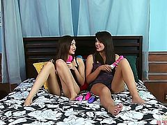 Brunette asian Natalie Heart touches her boobs gently