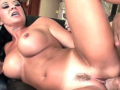 Young handsome stud Alex Gonz gets seduced by tanned brunette milf Raquel Devine with big juicy knockers and great hunger for cock and fucks her hard all over the living room.