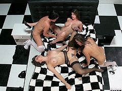 These four lesbians play with each other on a big bed. They have toys too, but they all use their fingers and tongues.