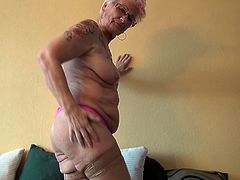 Gerdi is alone in her house and as we can see, she is desperate to make her pussy wet. So she starts putting her clothes off, one by one and reveals her attractive boobs. Now she is only in her panties and this granny is going to put them off as well, after enjoying a nice boobs grope by her own.