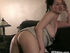 Enjoy this wild vid of the lovely brunette temptress Mina masturbating her shaved slit while wearing her new dress.
