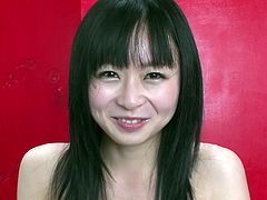 Fuckable Japanese milf shows off her steamy body while sitting on the couch in front of cam before she lies to finger her hairy vagina in sultry sex video by Jav HD.