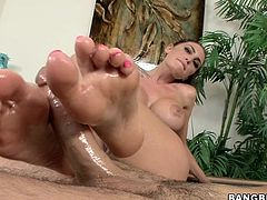 Lustful babe with her huge pair of boobs is pouring oil on her guy's big cock who is filming her. Her appealing body has given him a boner and she is dedicating all her skill to please her guy by rubbing his cock with her feet. Then she gets on her knees and continue to rub in different position.