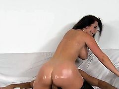 Jayden Jaymes stays in black stockings and in black high heeled shoes. Voodoo is licking her asshole before oiling ass of beauty as well as pounding her mouth and cunt.