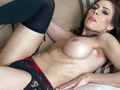 Erika Jordan is a big boobed seductress in black nylons. She poses topless and shows off her sexy jugs before she removes her revealing panties. Then she touches her snatch and exposes her bare butt.