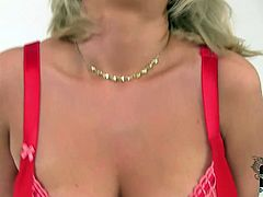 Guys, that light haired mommy has a huge all natural boobs! She takes off her top and red bra and gives us a great view of her saggy F cup melons.