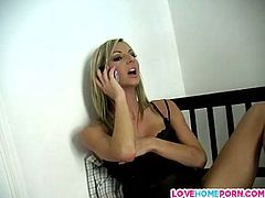 Clad in her sexy black lingerie is this pretty blonde chick who's talking naughty over the phone. Soon she's feeling horny that start to caress her tits, then pull her panty on the side to rub and cuddle her clit.