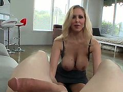 Julia Ann gets a mouthful of meat stick in blowjob action with horny fuck buddy