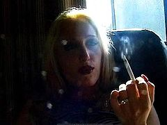 Blonde with big tits likes smoking and posing nude in the same time