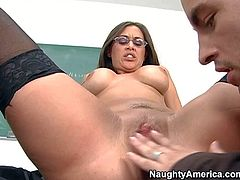 Kris Slater enjoys in staying after classes and getting his hands on his arousing brunette teacher with glasses and gets her shaved pussy served on table ready to be licked