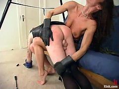 Kym Wilde is the brunette dominating a guy in this video, torturing his cock and humiliating him in diverse ways in this femdom BDSM vid.