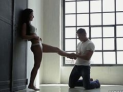 Adorable brunette princess stands close to wall letting her lover cover every inch of her legs with his tongue. Guy eats her wet pussy making her cum.
