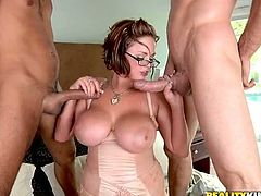 Stunning office chick with huge tits sucks two dicks at the business meeting. After that she gets fucked and facialed.