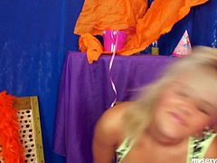 Flirty blond cutie strips in front of cam like a professional stripper before she lies to rub her aroused vagina with fingers in peppering sex clip by My Sexy Kittens.