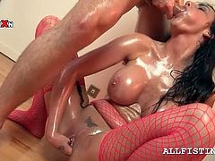 Slut in fishnets fisting her cunt hard while sucking a horny shaft