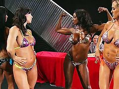 Four hot babes compete in Miss Titness America showing off thier sexy asses, cunts and boobs