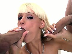 Hot and sexy blonde chick with medium tight boobies Erica Fontes got stack between two big dicked dudes and giving them deep throat blowjob.
