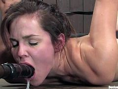 Attractive brunette Bobbi Starr is playing dirty games with some dude in a basement. She lets him put her into irons and then gets her mouth fucked with a dildo.