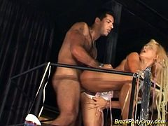 Beautiful busty babes participate in a Brazilian sex party. Some of them get fucked in all their holes.
