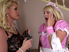 That blonde housemaid wants to be submissive to her mistress. That blonde vixen in black sexy dress will introduce her to BDSM.
