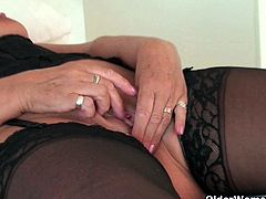 Busty and curvy granny Sandie is dressed up in black stockings and lingerie. She needs to get off and to do that she'll get herself comfortable and will open her legs to rub her clit.