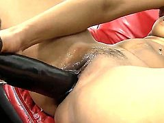Young turned on black bitch Black bitch Yasmine de Leon with colorful whorish nails and cheep heavy make up plays with vibrator and stuff her wet minge with gigantic dildo.