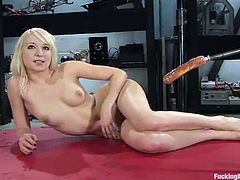 Stunning blonde girl with pretty face strips her clothes of and toys herself with a glass dildo. Later on she gets drilled in both holes at the same time by the fucking machine.