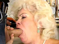 Cock hungry whorish blonde granny Effie with big hanging tits gives head to young buck with long shaft and gets hairy wet minge banged hard from behind in the kitchen.