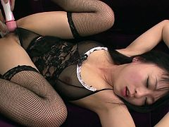 Hot blooded Japanese amateur lies on her back in steamy black lingerie getting her soaking hairy pussy poked hard with a dildo while getting her clit tickled with vibrator in peppering sex video by Jav HD.