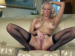 Samantha Alexandra is a seductive well-endowed blonde in black stockings and red shoes. She shows off her big tits as she rubs her twat hard with her long legs apart. Shes so hot!