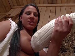 Yougn chick Betty dressed in white has lesbain fun in the barn with her best friend. Girls touch each others sexy tits and bare asses. They kiss and fondle each other with desire.