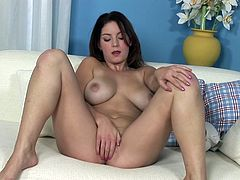 Watch this beautiful brunette having an amazing orgasm in this solo clip where you'll see her fingering her pink pussy with one hand and squeezing her big natural tits with the other.