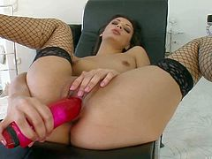 Sexy dark haired chick Nicole in even sexier in her new black fishnet stockings. She spreads her legs wide and makes pretty big pink dildo disappear in her love hole. Watch attractive brunette fuck herself with her toy.