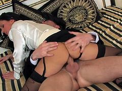 his meaty cock penetartes deep in her shaved pussy in riding style. She roles her eyes with pleasure and keeps jumping on him.