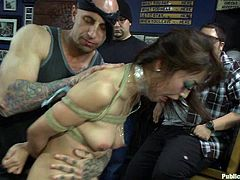 A hot whore gets restrained and fucking fucked and made to suck cock while bound in this extreme bondage scene right here!