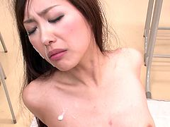 Divine Japanese babe sits on the table with legs spread aside in fishnet stockings in front of crowd of aroused dudes who poke her beaver with dildo before she gives simultaneous blowjob to 3 horny dicks in gangbang sex clip by Jav HD.