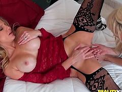 These extremely seductive chicks in sexy black stockings are more than just good friends. These busty chicks are lesbians and they know how to make sex more fun and exciting. At first, they just tease each other and then they eat each other's pussies.