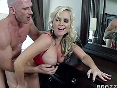 Turned on stud Johnny Sins with muscled body and shaved head gets seduced by smoking hot blonde with big tits and round jaw dropping ass and fucks her hard in bedroom