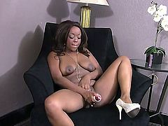 Turned on pretty black Roxy Pearl with hanging natural tits and round bouncing ass in white shoes only stuffs shaved minge with big vibrator to orgasm while teasing in armchair.