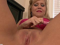 Get a load of this blonde milf's tight pink pussy in this solo video where she makes her wet pussy quiver with pleasure as she masturbates with a vibe.