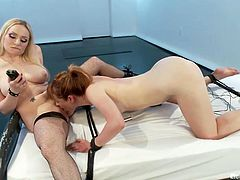 Tied on the bed with ropes and anxious to be punished by her mistress Claire is about to receive her treatment from Aiden. The hot blonde mistress attaches clamps with weights on those small tits and whips her ass before putting her to lick her pussy and give her something socking!