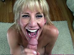 Slutty blonde mom Olivia Parrish demonstrates her nice boobs to the guy and turns him on. Then she favours him with a blowjob and lets him use her mouth as a cum target.