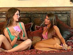 Hot brunette honey Emily Addison and her lusty friend enjoy in turning their interview into a hot and arousing lesbian sex session with fingering and kissing on bed