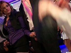 Steamy white milfs in sultry office wear dance rapaciously on the dance floor before they kneel down to give double blowjob in sizzling hot group sex video by Tainster.