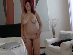 Attractive pale redhead babe Nanny with curvy hips and big natural hooters gets naked and teases dirty dude while he films her in bedroom in point of view