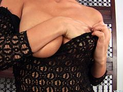 Fuckable blond milf in sultry black lingerie and stockings squeezes her big milky tits and shaved vagina in front of cam before she starts fingering herself in sultry sex video by Young Busty.
