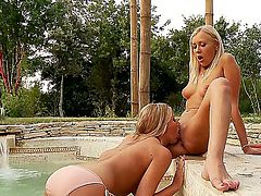 Smoking hot blonde cutties Danielle Maye and Teena Lipoldino with long legs and tight firm asses take off bikinis while making out and pleasure each other in jacuzzi in backyard.