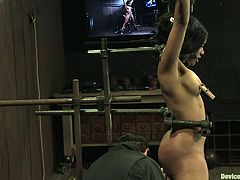 Watch this ebony hottie having her nipples tortured in this bondage scene while she's tied up and masturbated by a guy.